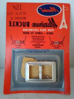 Belt Buckle vintage aluminum original sealed pkg for self co